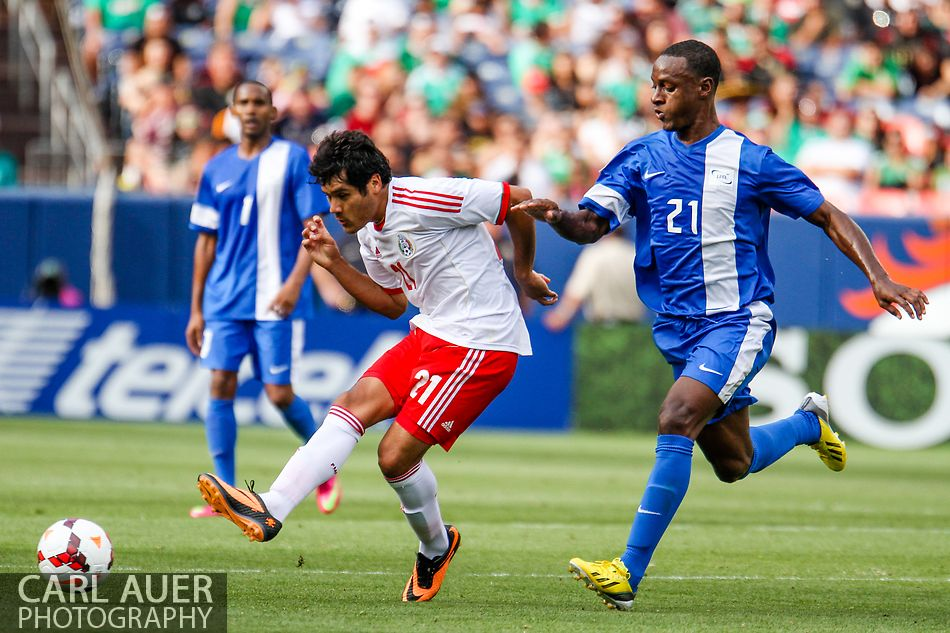 July 14 2013:  Mexico Forward Javier Orozco (21) attempts a shot past Martinique Defender Sebastien Cretinoir (21) in the second half of the CONCACAF Gold Cup soccer match between Martinique and Mexico at Sports Authority Field in Denver, CO. USA.