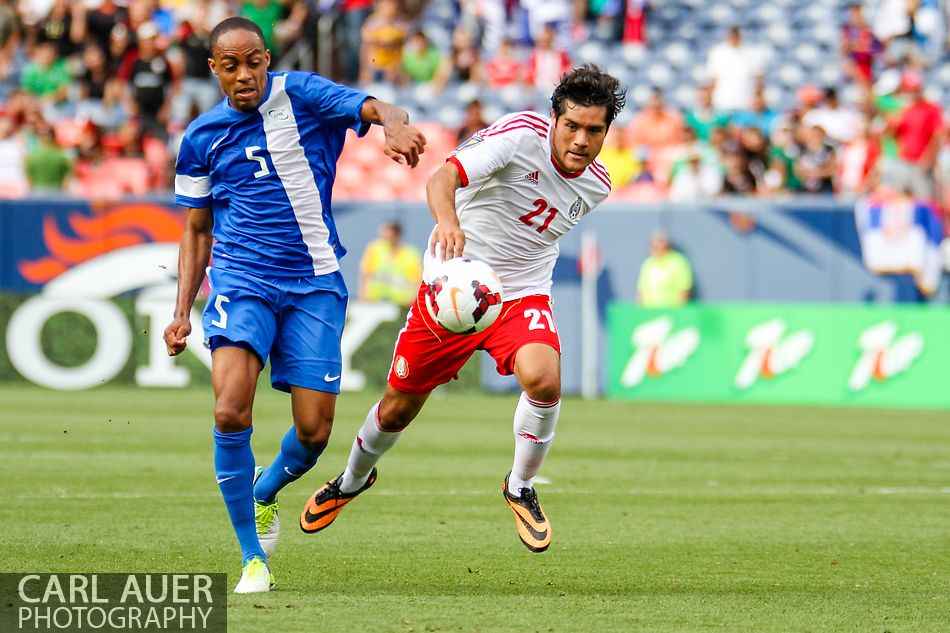 July 14 2013:  Martinique Midfield Gael Germany (5) and Mexico Forward Javier Orozco (21) chase after the ball in the second half of the CONCACAF Gold Cup soccer match between Martinique and Mexico at Sports Authority Field in Denver, CO. USA.