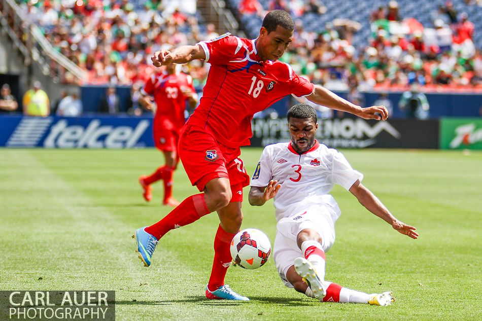 July 14 2013:  Panama Midfield Jairo Jimenez (18) attempts to avoid the tackle by Canada Defender Ashtone Morgan (3) as they continue to fight for the ball in the second half of the CONCACAF Gold Cup soccer match between Panama and Canada at Sports Authority Field in Denver, CO. USA.