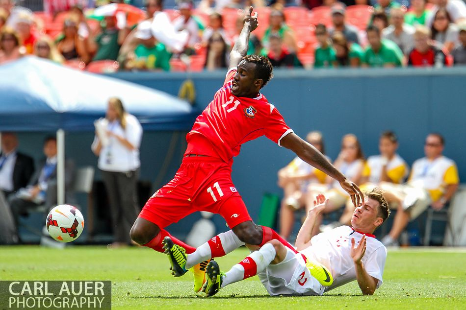 July 14 2013:  Panama Forward Cecilio Waterman (11) gets tangles up with Canada Defender Nikolas Ledgerwood (2) during the second half of the CONCACAF Gold Cup soccer match between Panama and Canada at Sports Authority Field in Denver, CO. USA.