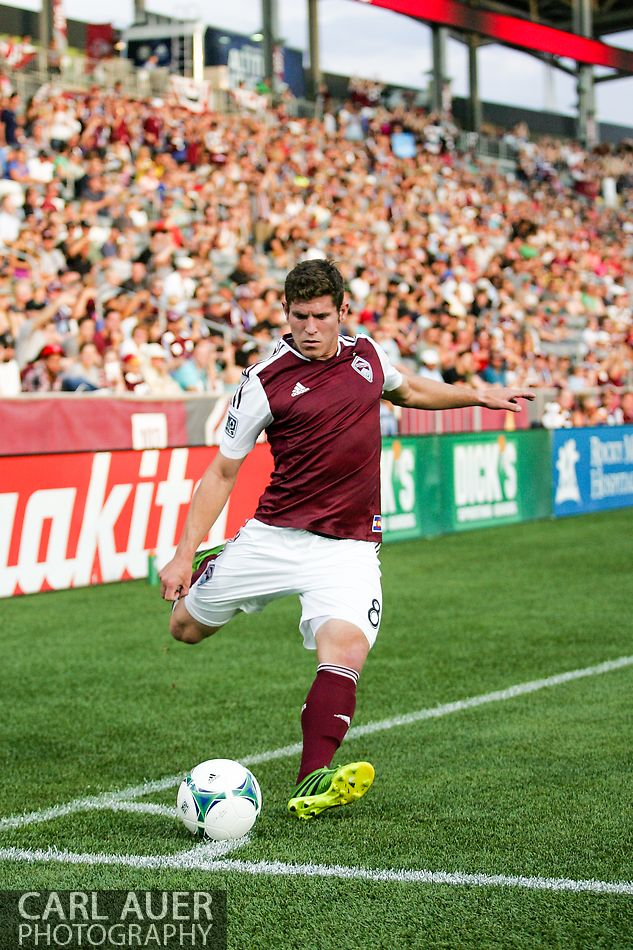 July 7th, 2013 - Colorado Rapids midfielder Dillon Powers (8) takes a corner kick attempt in the first half of action in the Major League Soccer match between D.C. United and the Colorado Rapids at Dick's Sporting Goods Park in Commerce City, CO
