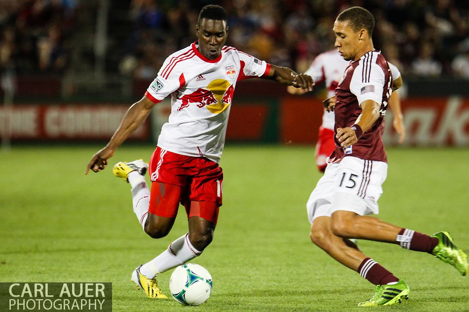 July 4th, 2013 - Colorado Rapids defender Chris Klute (15) attempts to stop the advancing New York Red Bulls midfielder Lloyd Sam (10) in the second half of action in the Major League Soccer match between New York Red Bulls and the Colorado Rapids at Dick's Sporting Goods Park in Commerce City, CO
