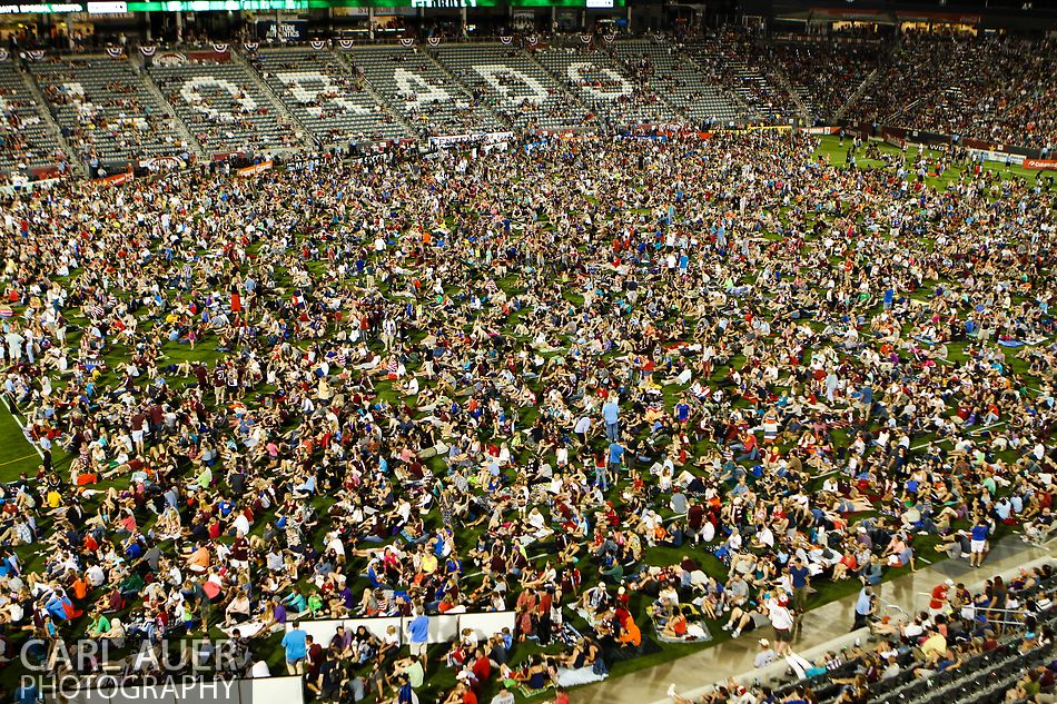 July 4th, 2013 - Fans gather on the soccer pitch to watch a fireworks show after the home team Colorado Rapids defeated the New York Red Bulls 2-0 in the Major League Soccer match at Dick's Sporting Goods Park in Commerce City, CO
