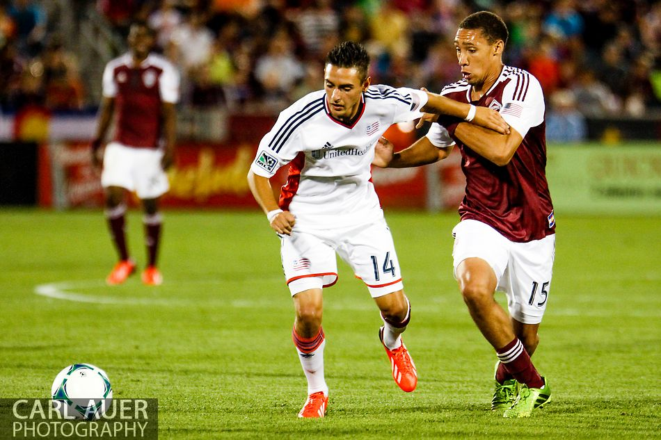 July 17th, 2013 - New England Revolution forward Diego Fagundez (14) and Colorado Rapids defender Chris Klute (15) battle for control of the ball in the second half of action in the Major League Soccer match between the New England Revolution and the Colorado Rapids at Dick's Sporting Goods Park in Commerce City, CO