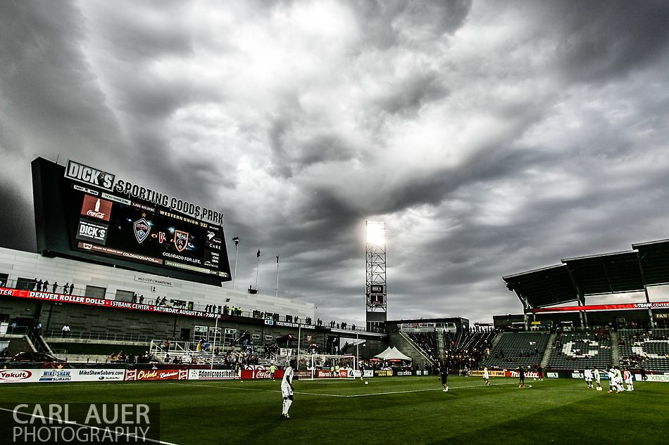 August 3rd, 2013 - Ominous clouds roll in over the pitch as the teams warm up prior to the start of the Major League Soccer match between Real Salt Lake and the Colorado Rapids at Dick's Sporting Goods Park in Commerce City, CO