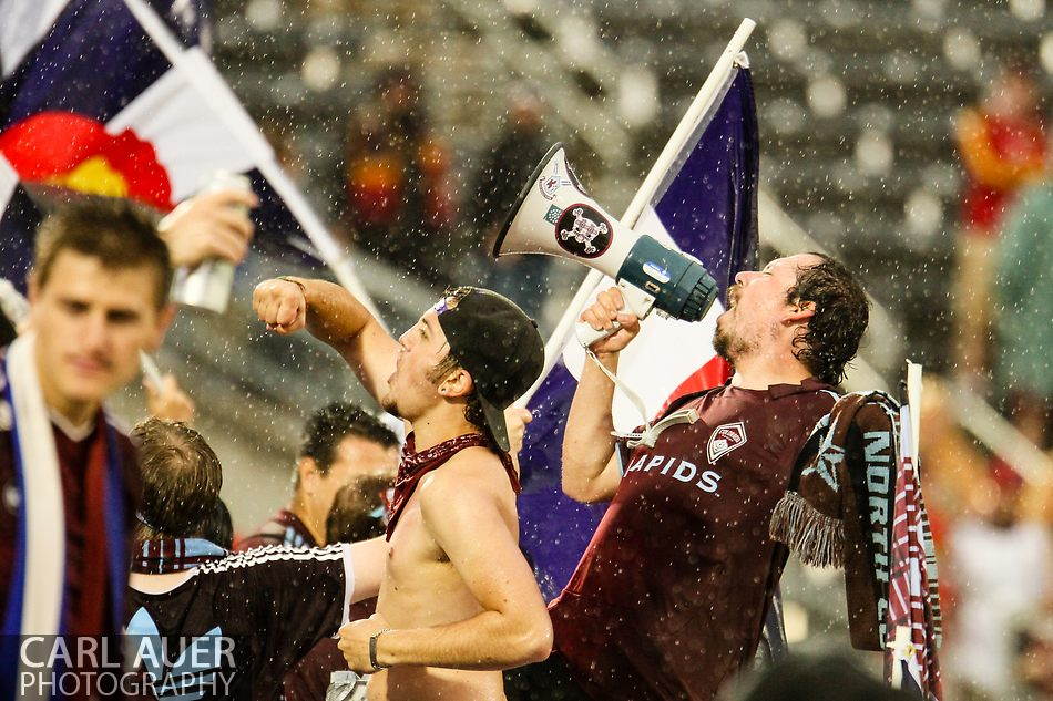 August 3rd, 2013 - Rain drenched fans cheer after the players take the field to complete the first half after a 62 minute lightning delay duringthe Major League Soccer match between Real Salt Lake and the Colorado Rapids at Dick's Sporting Goods Park in Commerce City, CO