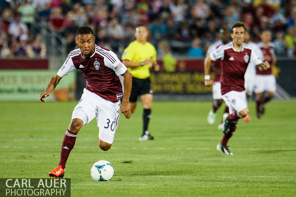 August 17th, 2013 - In his first MLS match, Colorado Rapids forward Gabriel Torres (30) drives the ball up the field in the first half of the Major League Soccer match between the Vancouver Whitecaps FC and the Colorado Rapids at Dick's Sporting Goods Park in Commerce City, CO