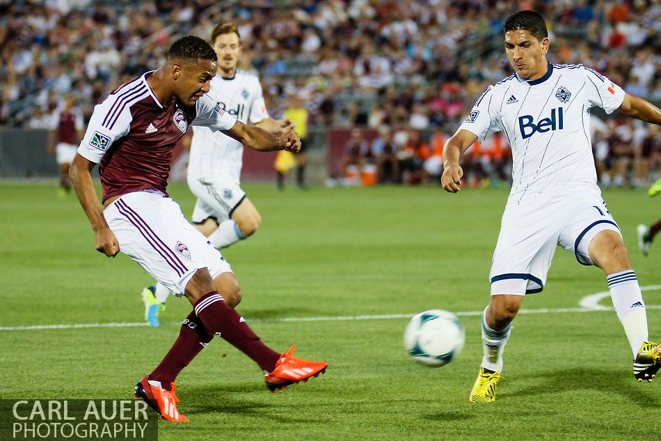 August 17th, 2013 - Colorado Rapids forward Gabriel Torres (30) takes a shot on goal in the first half of action in the Major League Soccer match between the Vancouver Whitecaps FC and the Colorado Rapids at Dick's Sporting Goods Park in Commerce City, CO