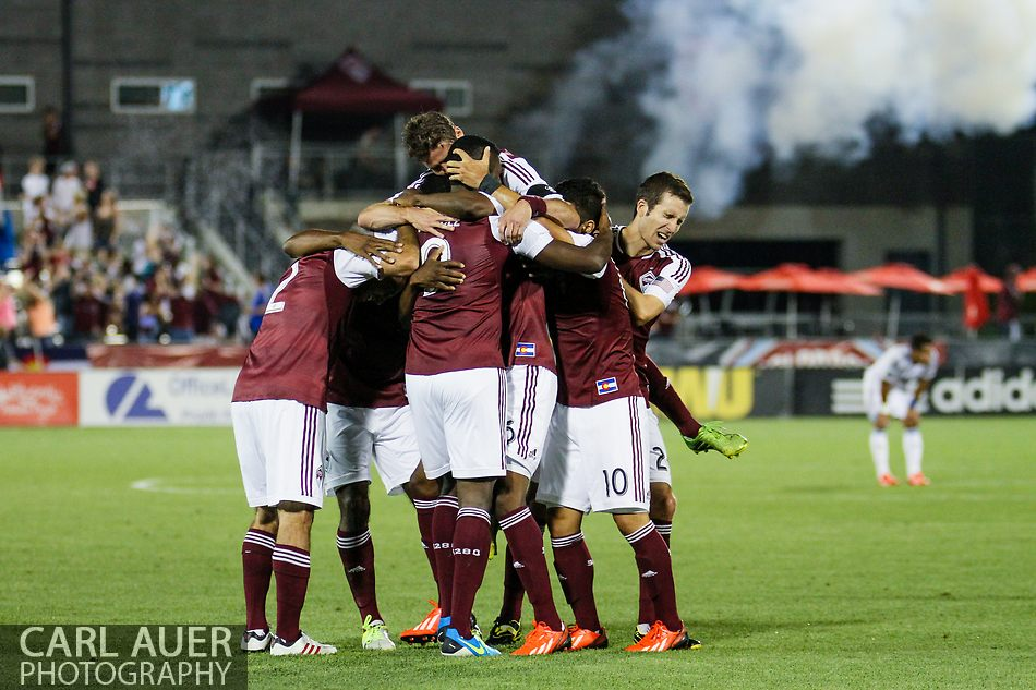 August 17th, 2013 - The Colorado Rapids surround forward Edson Buddle (9) after his goal in the second half of the Major League Soccer match between the Vancouver Whitecaps FC and the Colorado Rapids at Dick's Sporting Goods Park in Commerce City, CO