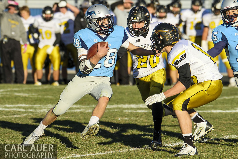 November 1, 2013: Ralston Valley Mustangs junior running back Andrew Wingard (28) attempts to split the Arapahoe Warriors defense in the first round game of the CHSAA 5A State Championship Playoffs at the North Area Athletic Complex in Arvada, CO
