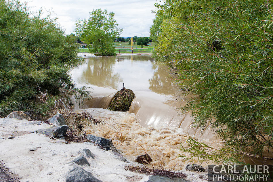 September 13, 2013: A small creek in on Alkire Street in Arvada, CO that is fed by Leyden Lake overflows into yards near the Youth Memorial Sports Complex after record breaking rains hit Colorado over the last few days (Carl Auer)